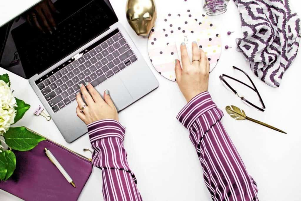 Hands of blogger on laptop