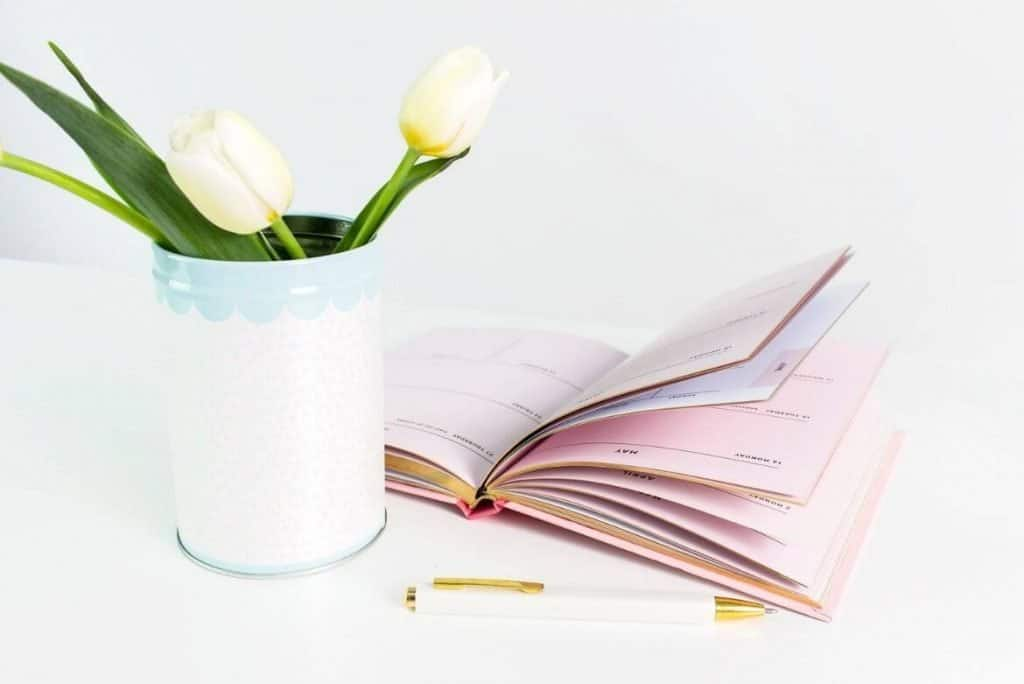 flower and planner on desktop